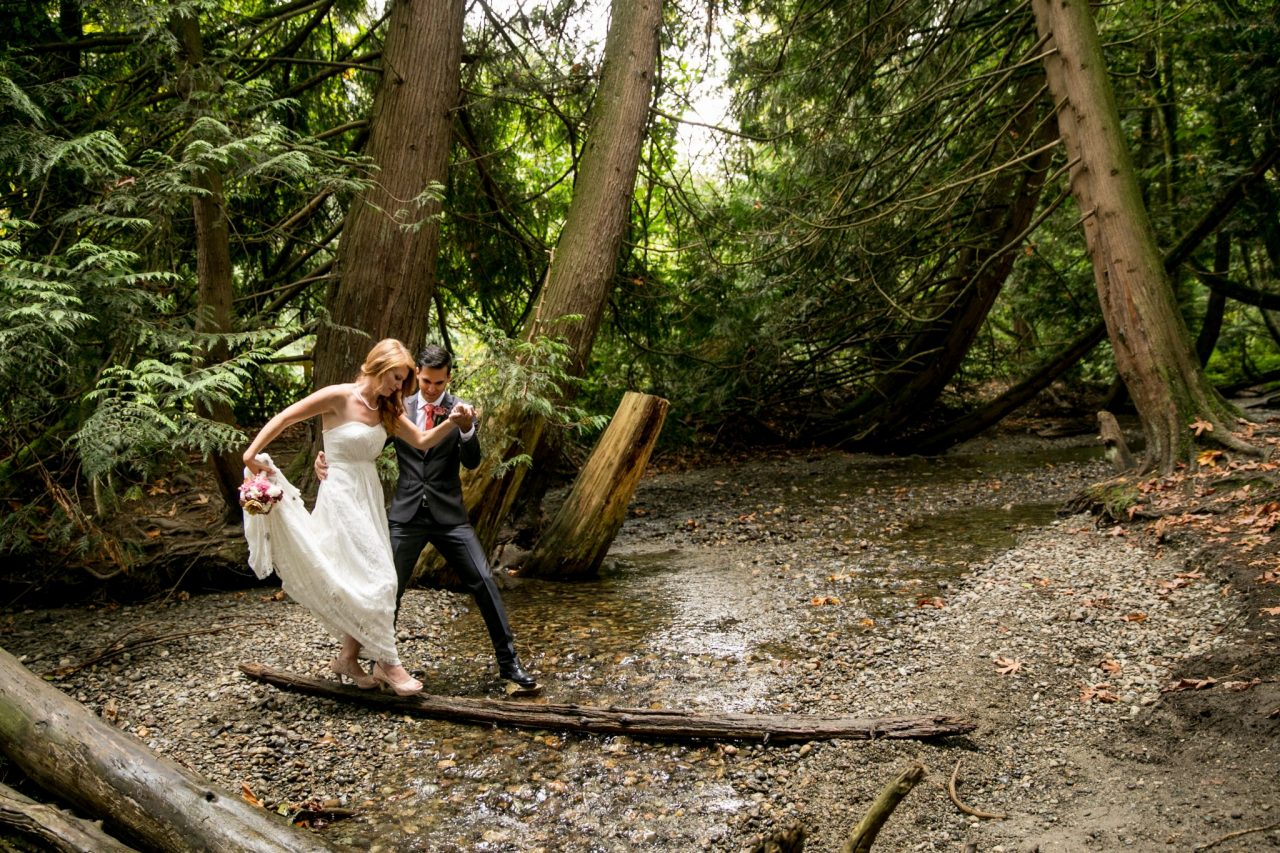 Bride and groom posing in forest near creek abbotsford | Nanaimo wedding photographer