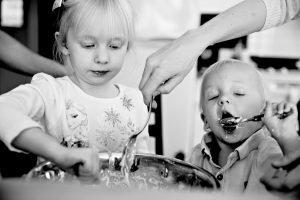 two kids making pancakes at home in Kelowna